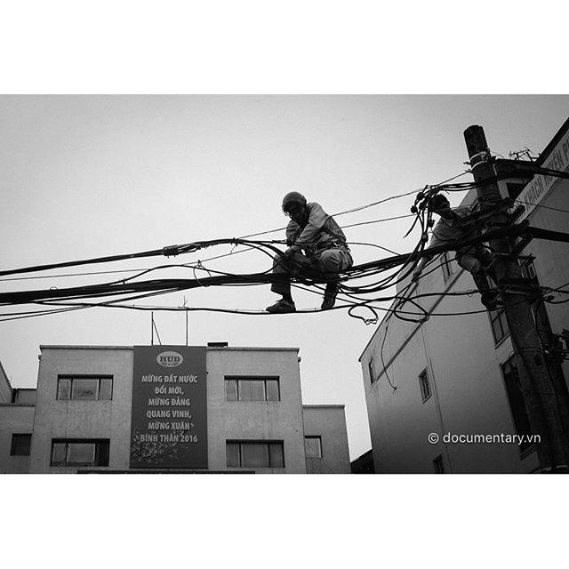 [Instagram] #workers #climbing #electricline #propoganda #summer #hanoi #vietnam